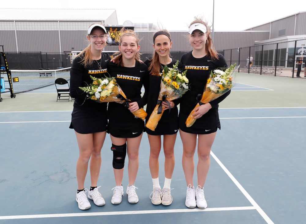 Iowa seniors Montana Crawford, Zoe Douglas, Adrienne Jensen, and Anastasia Reimchen during Senior Day activities before their match against the Wisconsin Badgers Sunday, April 22, 2018 at the Hawkeye Tennis and Recreation Center. (Brian Ray/hawkeyesports.com)