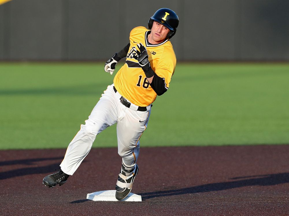 Iowa Hawkeyes shortstop Tanner Wetrich (16) rounds second base after hitting an RBI triple during the seventh inning of their game against Northern Illinois at Duane Banks Field in Iowa City on Tuesday, Apr. 16, 2019. (Stephen Mally/hawkeyesports.com)