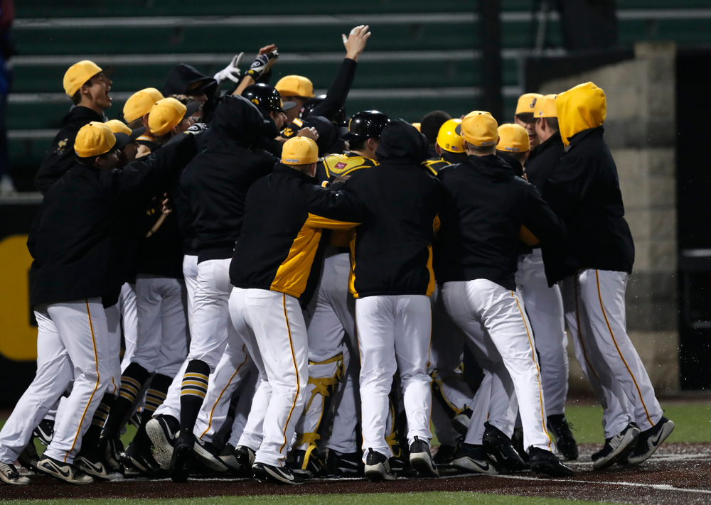 Iowa Hawkeyes catcher Tyler Cropley (5) celebrates after hitting a walk off grand slam in the bottom of the ninth against the Bradley Braves Wednesday, March 28, 2018 at Duane Banks Field. (Brian Ray/hawkeyesports.com)