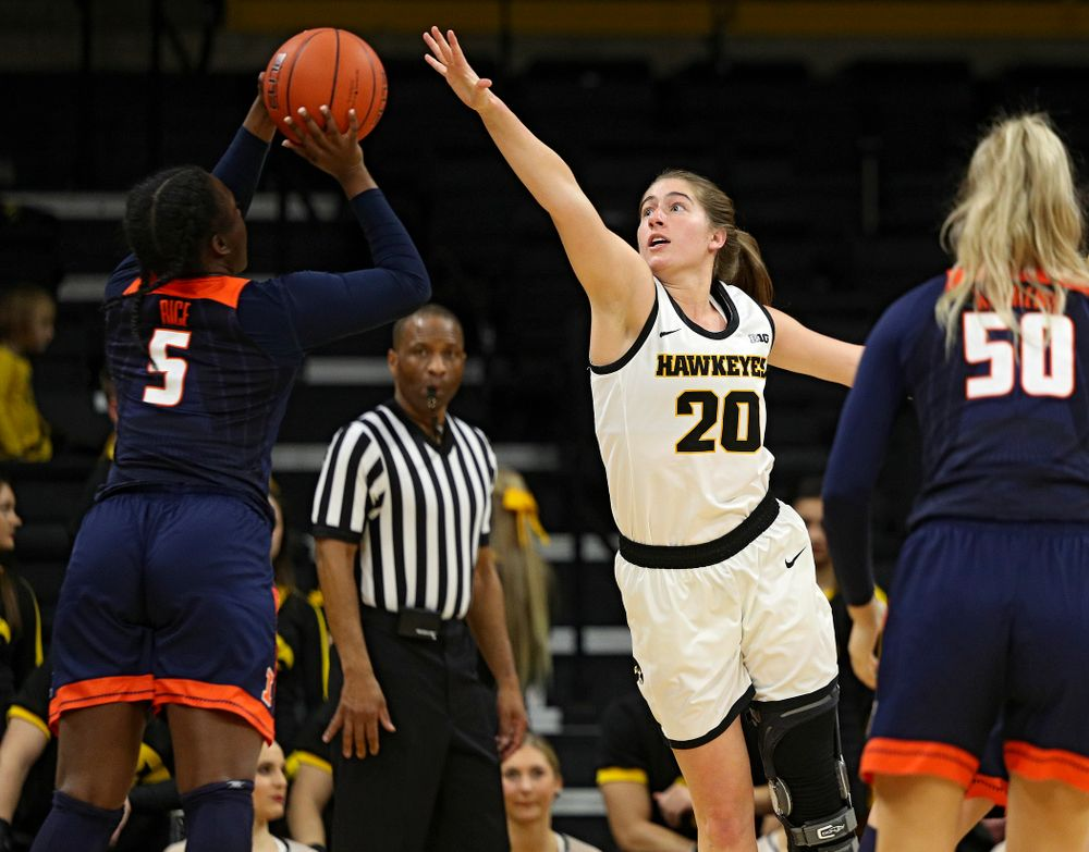 Iowa Hawkeyes guard Kate Martin (20) reaches for a shot during the third quarter of their game at Carver-Hawkeye Arena in Iowa City on Tuesday, December 31, 2019. (Stephen Mally/hawkeyesports.com)
