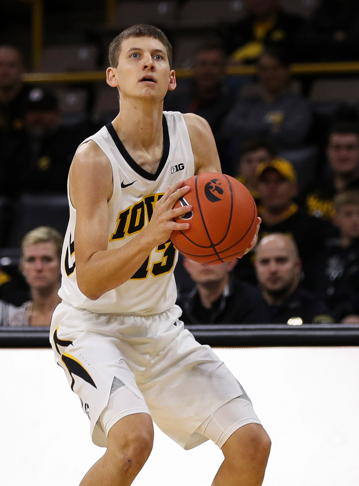 Iowa Hawkeyes guard Austin Ash (13) prepares to shoot a 3-pointer during a game against Guilford College at Carver-Hawkeye Arena on November 4, 2018. (Tork Mason/hawkeyesports.com)