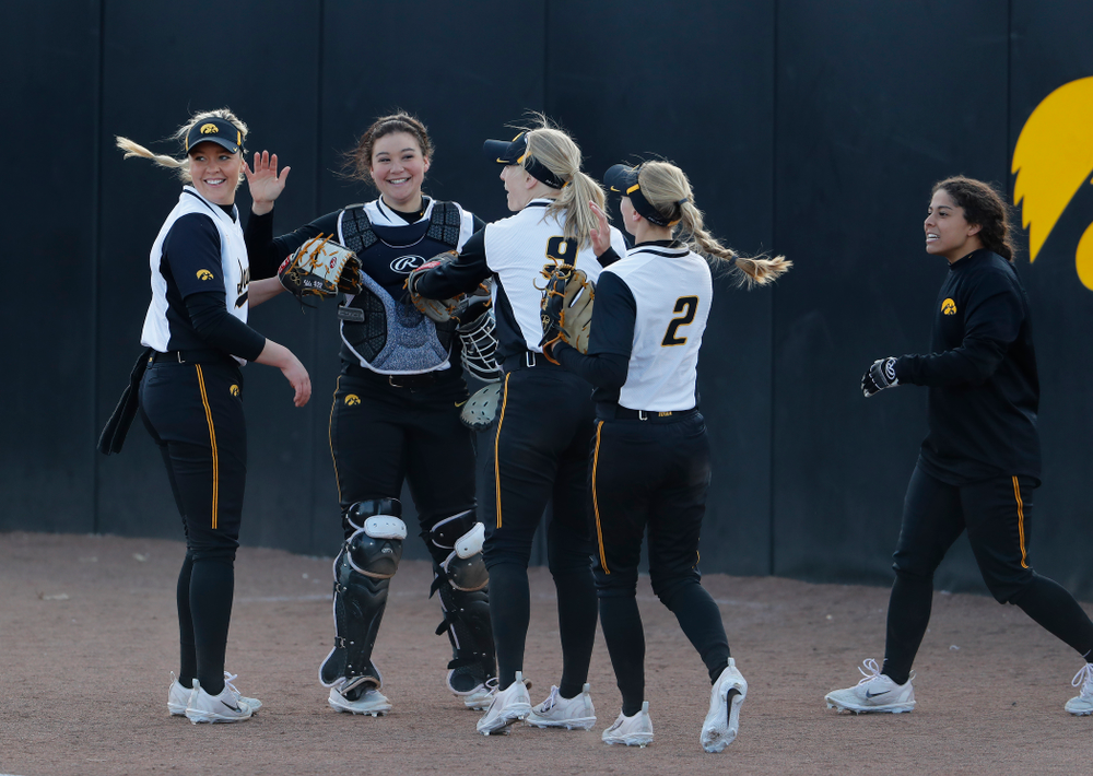 Iowa Hawkeyes starting pitcher/relief pitcher Kenzie Ihle (22) and infielder Taylor Libby (4)