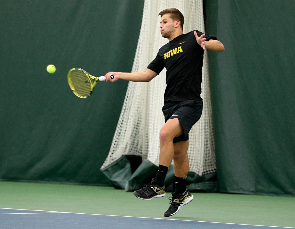 Iowa's Will Davies returns a shot during his doubles match at the Hawkeye Tennis and Recreation Complex in Iowa City on Friday, February 14, 2020. (Stephen Mally/hawkeyesports.com)