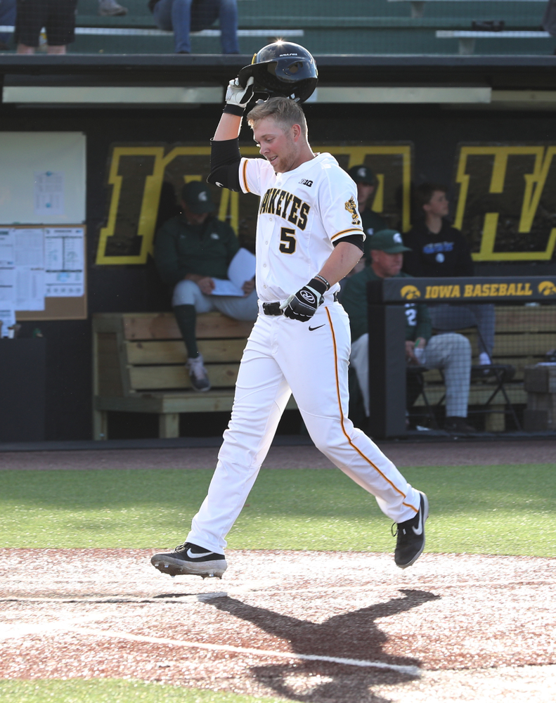 Iowa Hawkeyes Zeb Adreon (5) celebrates a grand slam against the Michigan State Spartans Friday, May 10, 2019 at Duane Banks Field. (Brian Ray/hawkeyesports.com)