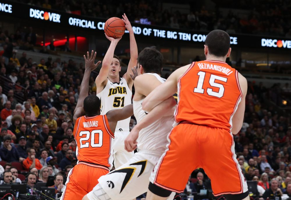 Iowa Hawkeyes forward Nicholas Baer (51) against the Illinois Fighting Illini in the 2019 Big Ten Men's Basketball Tournament Thursday, March 14, 2019 at the United Center in Chicago. (Brian Ray/hawkeyesports.com)