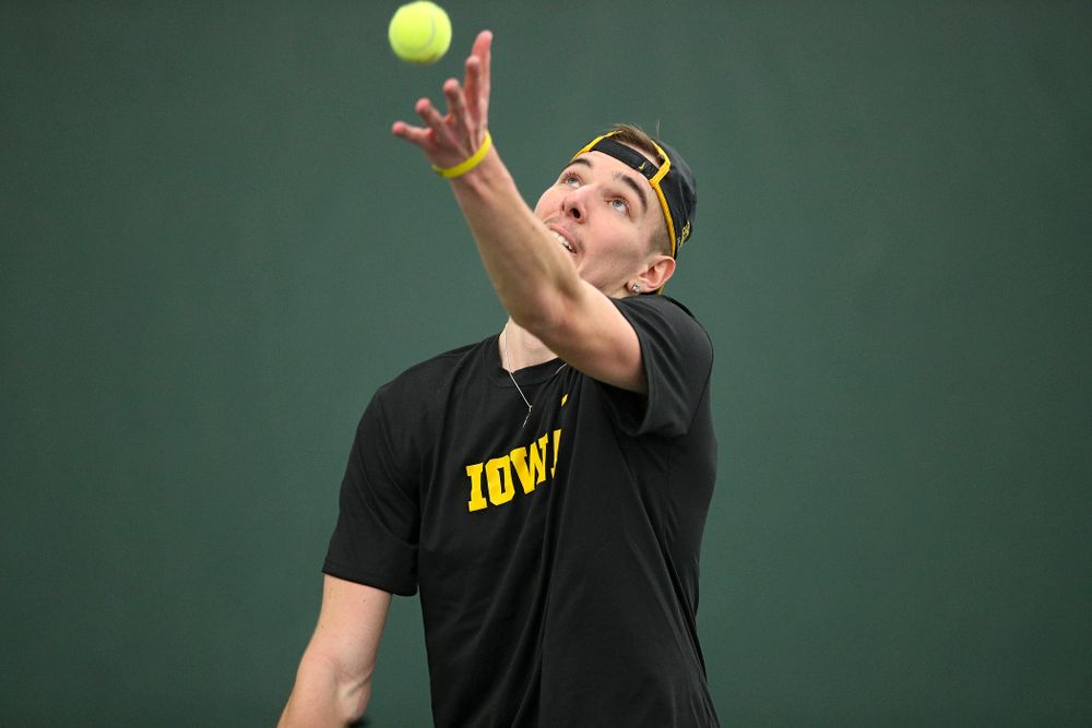 Iowa's Nikita Snezhko serves during his singles match at the Hawkeye Tennis and Recreation Complex in Iowa City on Friday, February 14, 2020. (Stephen Mally/hawkeyesports.com)
