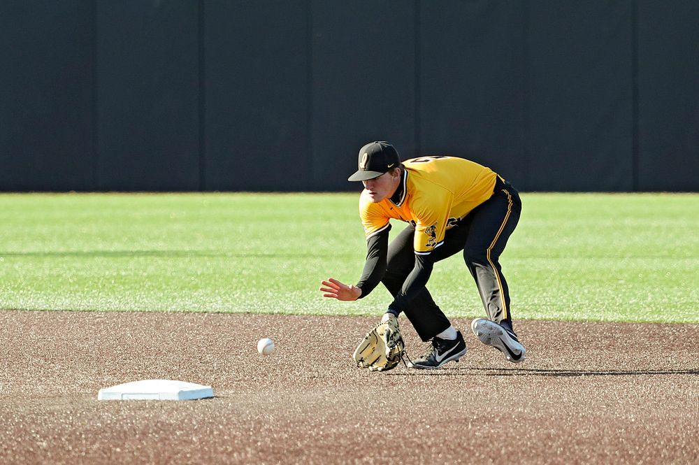 Iowa Hawkeyes shortstop Brendan Sher (2) fields a ground ball before stepping on second base while turning a double play during the third inning of their game at Duane Banks Field in Iowa City on Tuesday, Apr. 2, 2019. (Stephen Mally/hawkeyesports.com)