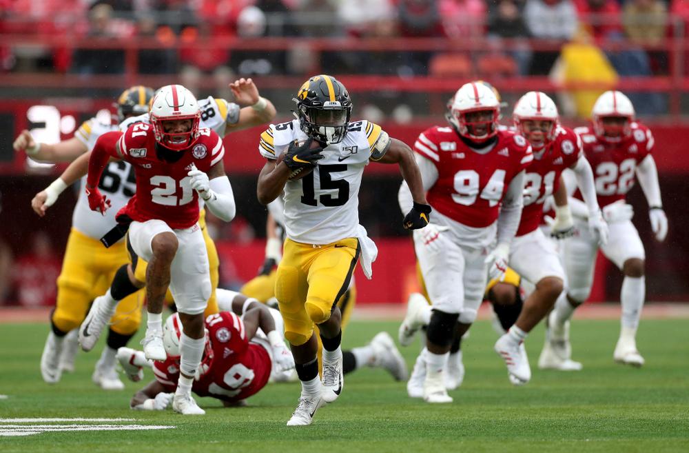 Iowa Hawkeyes running back Tyler Goodson (15) breaks free on a long touchdown run against the Nebraska Cornhuskers Friday, November 29, 2019 at Memorial Stadium in Lincoln, Neb. (Brian Ray/hawkeyesports.com)