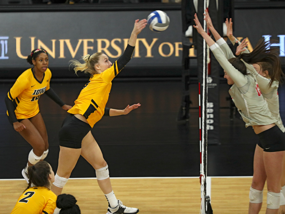 Iowa's Kyndra Hansen (8) gets a kill during the third set of their match at Carver-Hawkeye Arena in Iowa City on Friday, Nov 29, 2019. (Stephen Mally/hawkeyesports.com)