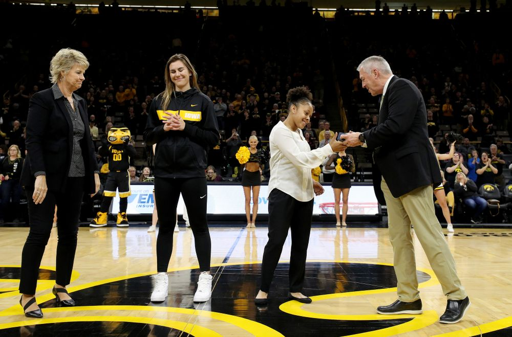 Former Hawkeye Tania Davis receives her Big Ten Tournament championship ring from  Henry B. and Patricia B. Tippie Director of Athletics Chair Gary Barta before the Iowa Hawkeyes game against Clemson Wednesday, December 4, 2019 at Carver-Hawkeye Arena. (Brian Ray/hawkeyesports.com)