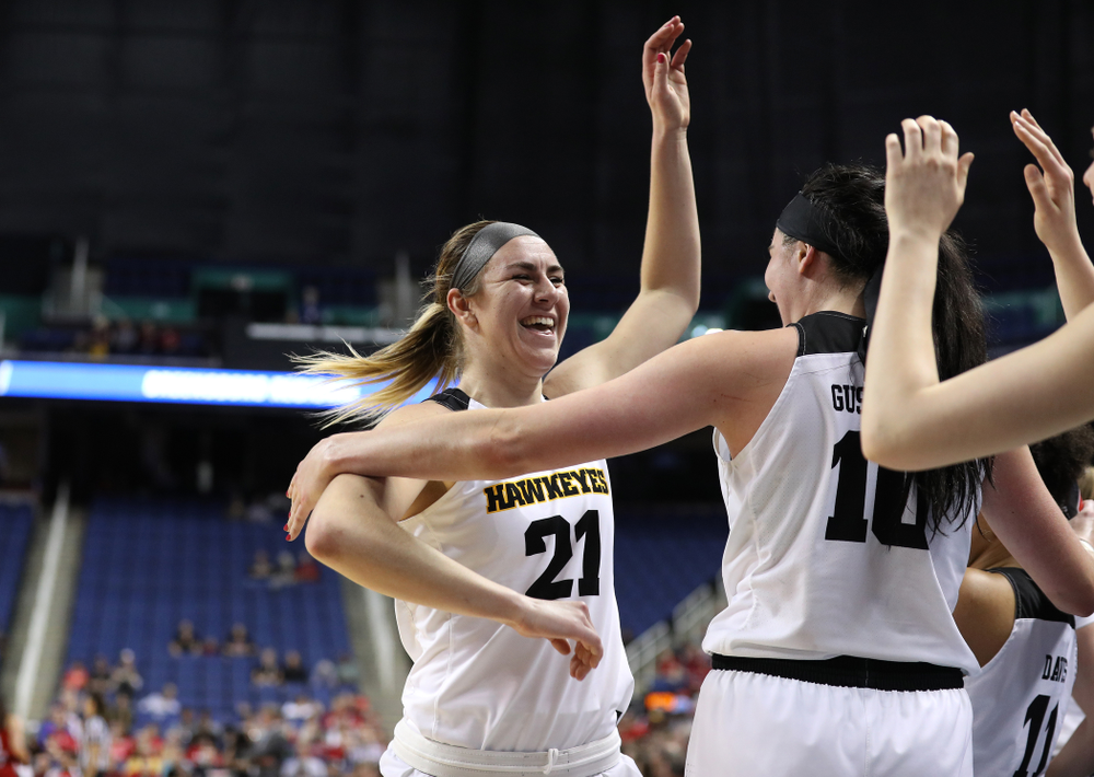 Iowa Hawkeyes forward Hannah Stewart (21) and forward Megan Gustafson (10) against the NC State Wolfpack in the regional semi-final of the 2019 NCAA Women's College Basketball Tournament Saturday, March 30, 2019 at Greensboro Coliseum in Greensboro, NC.(Brian Ray/hawkeyesports.com)