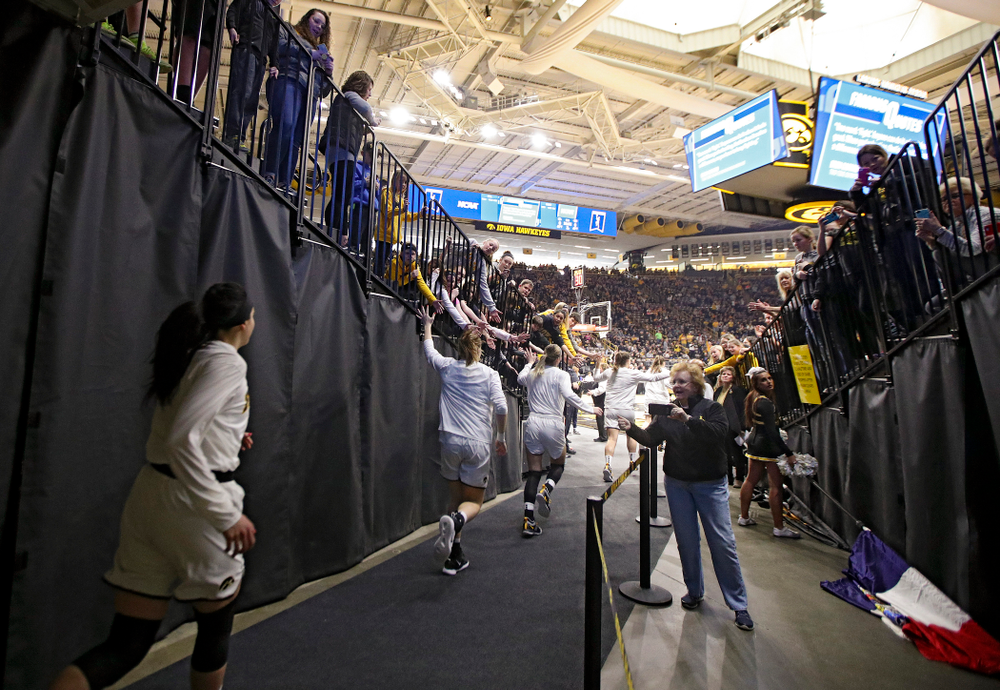The Iowa Hawkeyes run onto the court before their second round game in the 2019 NCAA Women's Basketball Tournament at Carver Hawkeye Arena in Iowa City on Sunday, Mar. 24, 2019. (Stephen Mally for hawkeyesports.com)