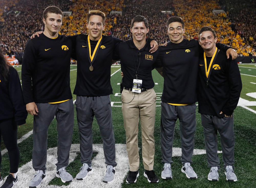Members of the Iowa men's gymnastics team are recognized by the Presidential Committee on Athletics at halftime during a game against Wisconsin on September 22, 2018. (Tork Mason/hawkeyesports.com)
