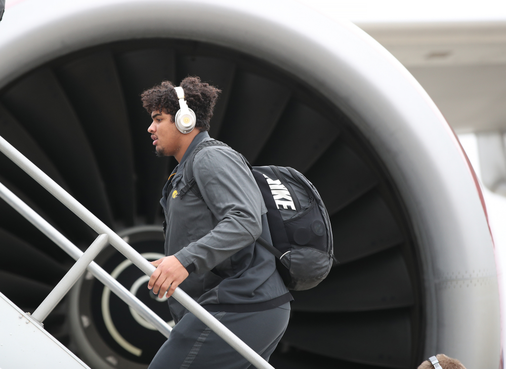 Iowa Hawkeyes offensive lineman Tristan Wirfs (74) boards the team plane Wednesday, December 26, 2018 as they travel to Tampa, Florida for the Outback Bowl. (Brian Ray/hawkeyesports.com)
