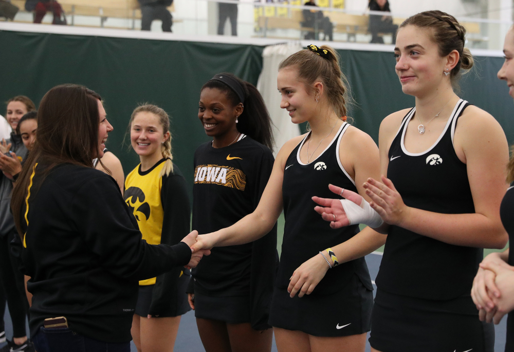 Academic Student Services Associate Director Kara Park congratulates Ashleigh Jacobs for earning a 3.0 GPA or better during the fall semester before their match against the Penn State Nittany Lions Sunday, February 24, 2019 at the Hawkeye Tennis and Recreation Complex. (Brian Ray/hawkeyesports.com)