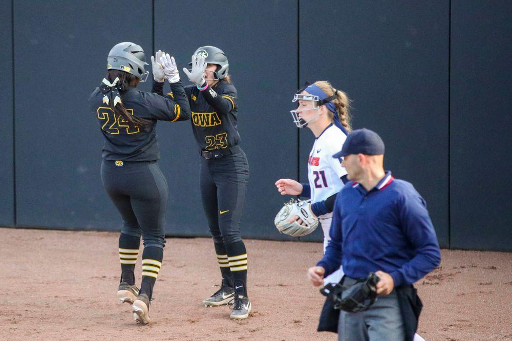 IowaÕs Donirae Mayhew (24) and IowaÕs Alex Rath (23) at softball vs Illinois game 3 on Saturday, April 13, 2019 at Bob Pearl Field. (Lily Smith/hawkeyesports.com)