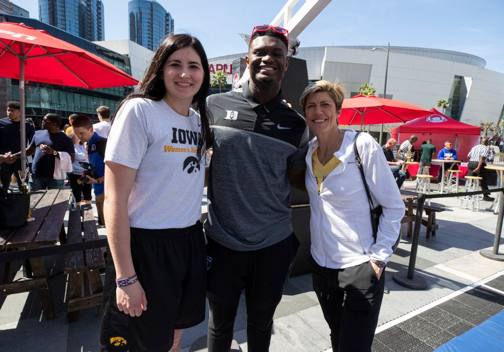 Iowa Hawkeyes forward Megan Gustafson (10) and associate head coach Jan Jensen take a photo with DukeÕs Zion Williamson Friday, April 12, 2019 during an event in the XBOX Plaza at LA Live.  (Brian Ray/hawkeyesports.com)
