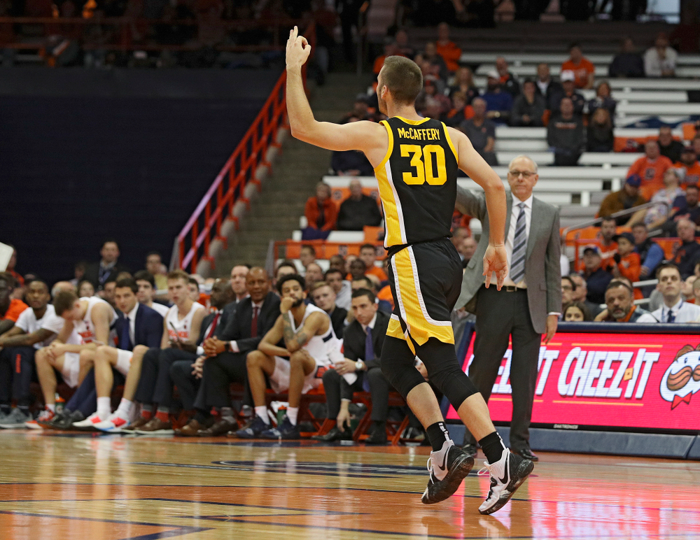Iowa Hawkeyes guard Connor McCaffery (30) holds up three fingers after making a 3-pointer during the second half of their ACC/Big Ten Challenge game at the Carrier Dome in Syracuse, N.Y. on Tuesday, Dec 3, 2019. (Stephen Mally/hawkeyesports.com)