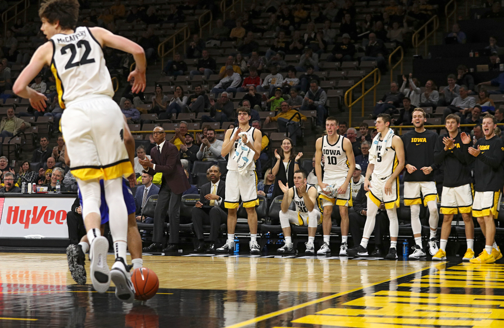 The Iowa Hawkeyes bench reacts after forward Patrick McCaffery (22) dunked the ball during the second half of their exhibition game against Lindsey Wilson College at Carver-Hawkeye Arena in Iowa City on Monday, Nov 4, 2019. (Stephen Mally/hawkeyesports.com)