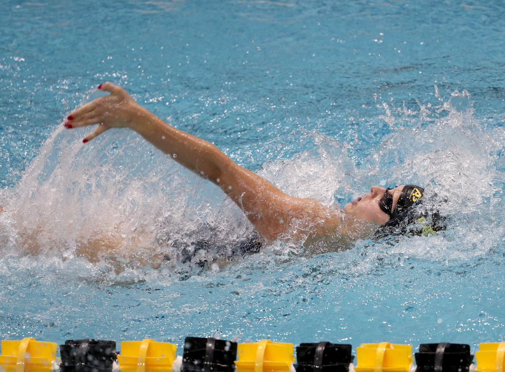 IowaÕs Julia Koluch competes in the 100 yard backstroke against Notre Dame and Illinois Saturday, January 11, 2020 at the Campus Recreation and Wellness Center.  (Brian Ray/hawkeyesports.com)