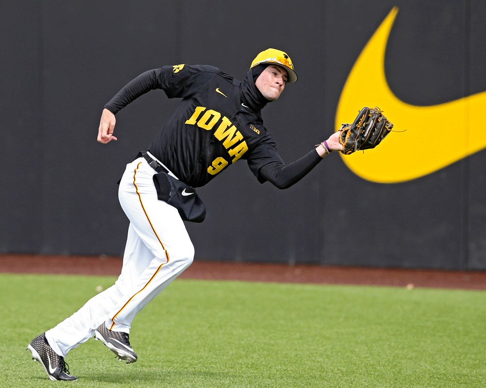 Iowa Hawkeyes right fielder Ben Norman (9) pulls in a fly ball for an out during the second inning of their game against Illinois at Duane Banks Field in Iowa City on Saturday, Mar. 30, 2019. (Stephen Mally/hawkeyesports.com)