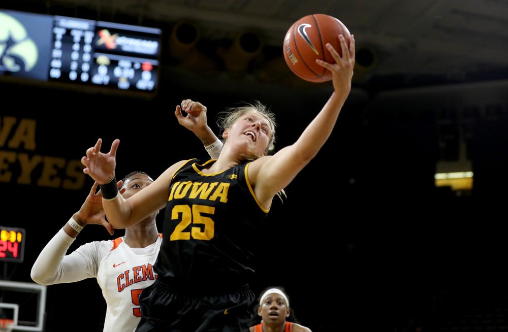 Iowa Hawkeyes forward/center Monika Czinano (25) pulls down a pass against Clemson Wednesday, December 4, 2019 at Carver-Hawkeye Arena. (Brian Ray/hawkeyesports.com)