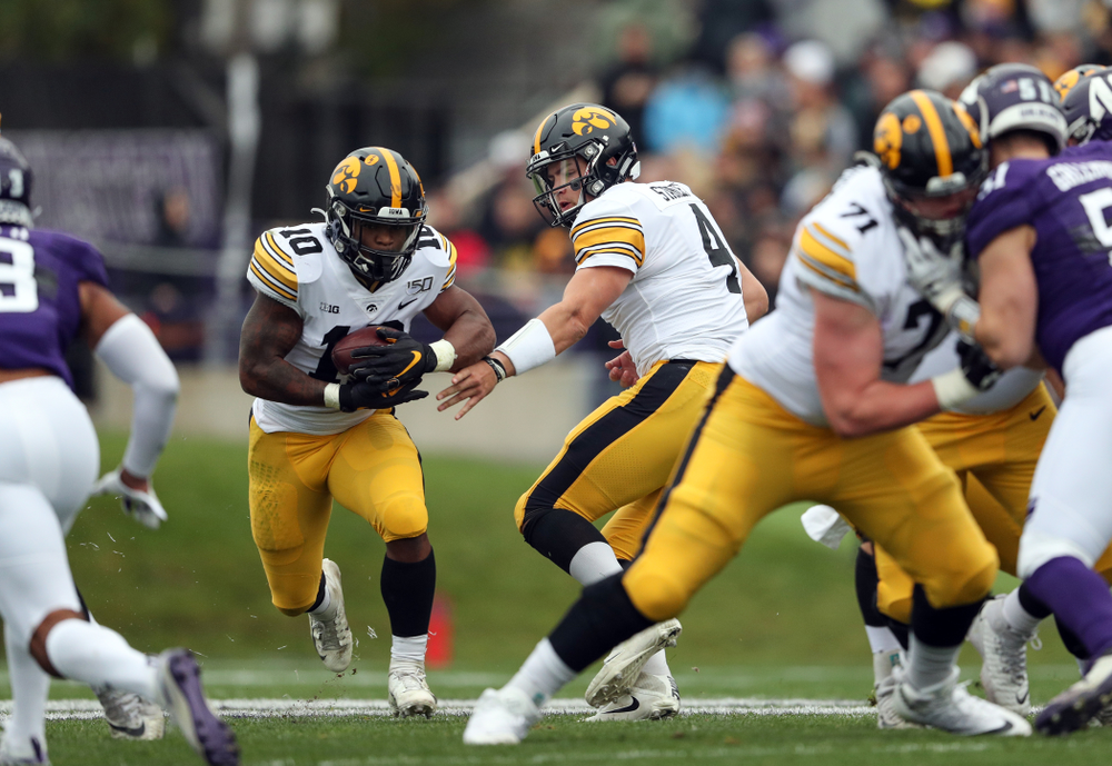Iowa Hawkeyes running back Mekhi Sargent (10) and quarterback Nate Stanley (4) against the Northwestern Wildcats Saturday, October 26, 2019 at Ryan Field in Evanston, Ill. (Brian Ray/hawkeyesports.com)