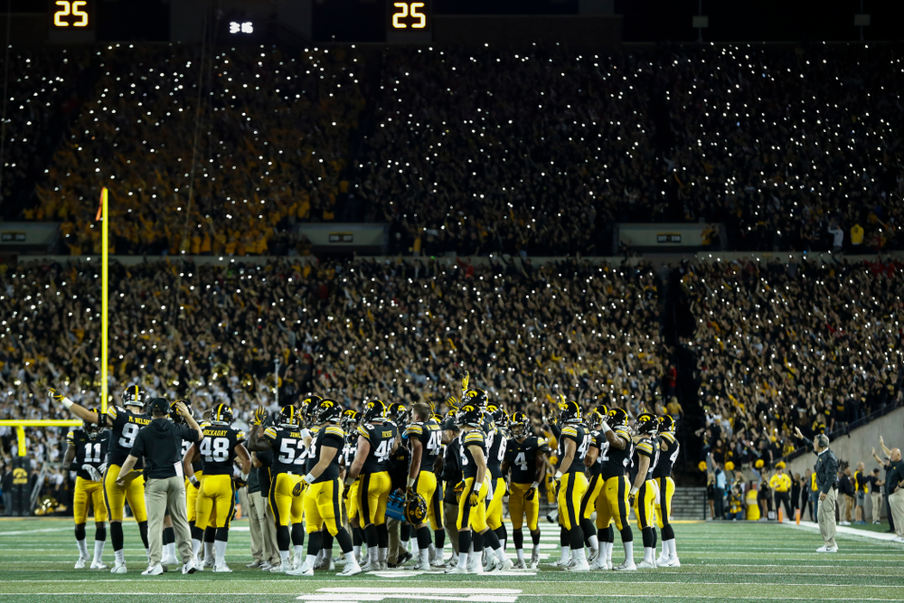 The Iowa Hawkeyes wave to the Stead Family Children's Hospital during their game against the Wisconsin Badgers Saturday, September 22, 2018 at Kinnick Stadium. (Brian Ray/hawkeyesports.com)