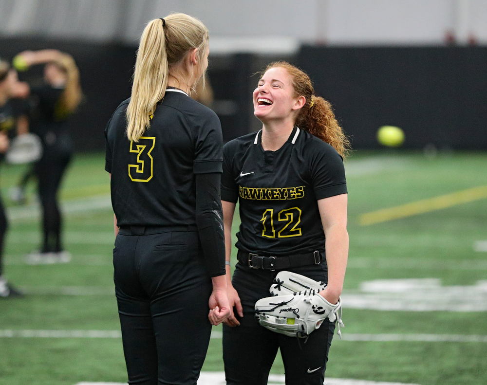 Iowa pitcher Allison Doocy (3) and catcher/infielder Kate Claypool (12) share a laugh during Iowa Softball Media Day at the Hawkeye Tennis and Recreation Complex in Iowa City on Thursday, January 30, 2020. (Stephen Mally/hawkeyesports.com)