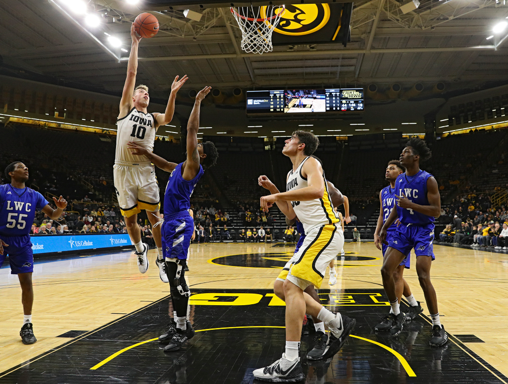 Iowa Hawkeyes guard Joe Wieskamp (10) makes a basket as center Luka Garza (55) looks on during the first half of their exhibition game against Lindsey Wilson College at Carver-Hawkeye Arena in Iowa City on Monday, Nov 4, 2019. (Stephen Mally/hawkeyesports.com)