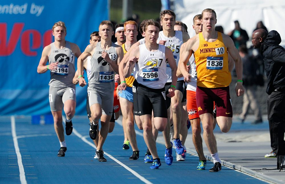 Iowa's Josh Andrews (from left) and Tyler Olson run the men's 800 meter event during the first day of the Drake Relays at Drake Stadium in Des Moines on Thursday, Apr. 25, 2019. (Stephen Mally/hawkeyesports.com)