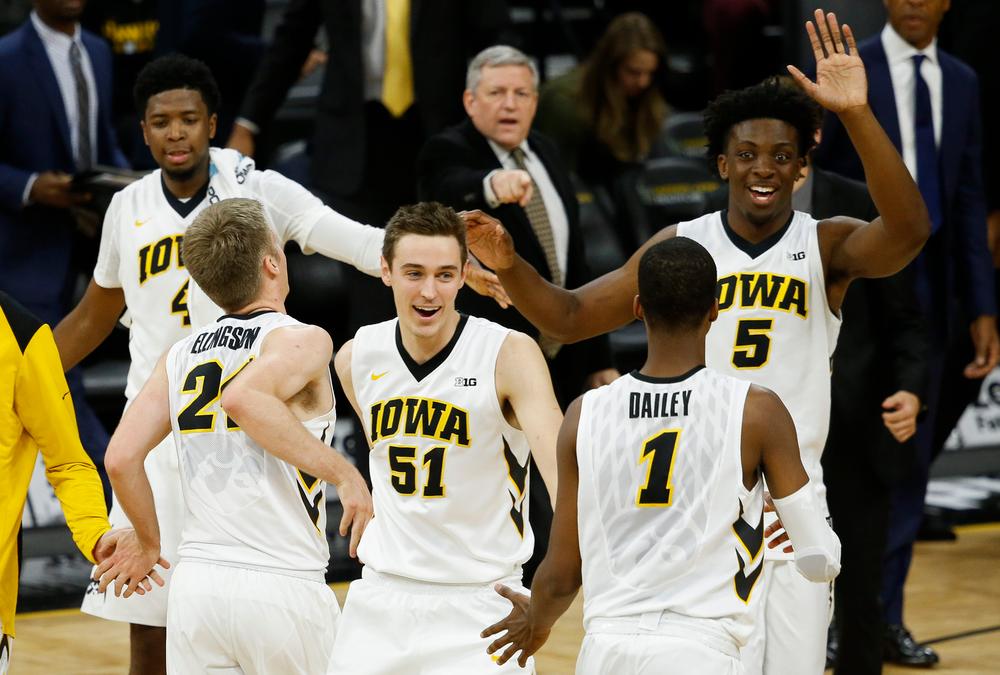 Iowa Hawkeyes forwards Nicholas Baer (51) and Tyler Cook (5)