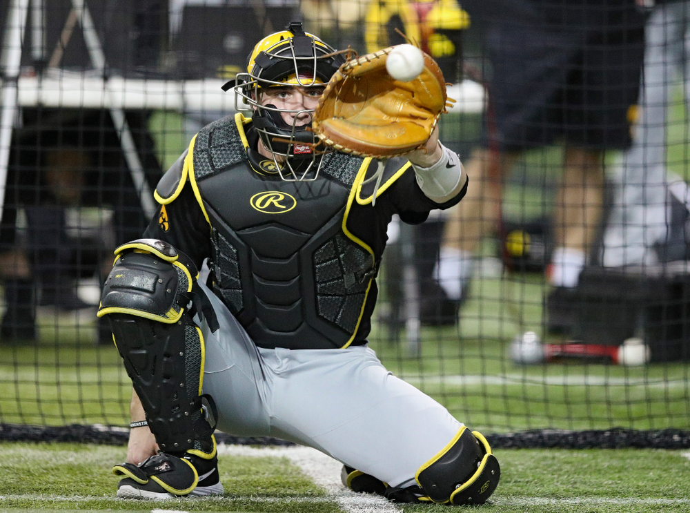 Iowa Hawkeyes catcher Austin Martin (34) looks in a pitch during practice at the Hansen Football Performance Center in Iowa City on Friday, January 24, 2020. (Stephen Mally/hawkeyesports.com)
