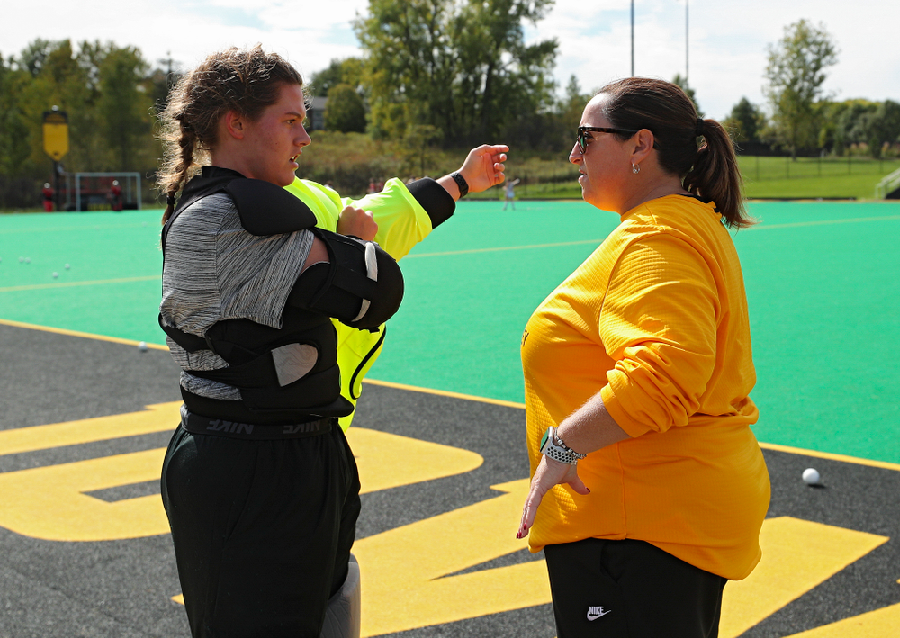 Iowa's Grace McGuire (62) talks with head coach Lisa Cellucci before the start of their match at Grant Field in Iowa City on Friday, Oct 4, 2019. (Stephen Mally/hawkeyesports.com)