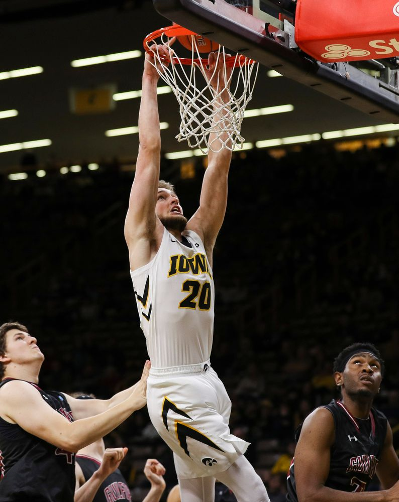 Iowa Hawkeyes forward Riley Till (20) goes up for a dunk during a game against Guilford College at Carver-Hawkeye Arena on November 4, 2018. (Tork Mason/hawkeyesports.com)