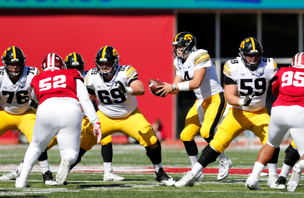 Iowa Hawkeyes offensive lineman Dalton Ferguson (76), offensive lineman Keegan Render (69), and offensive lineman Ross Reynolds (59) block for quarterback Nate Stanley (4) against the Indiana Hoosiers Saturday, October 13, 2018 at Memorial Stadium, in Bloomington, Ind. (Brian Ray/hawkeyesports.com)