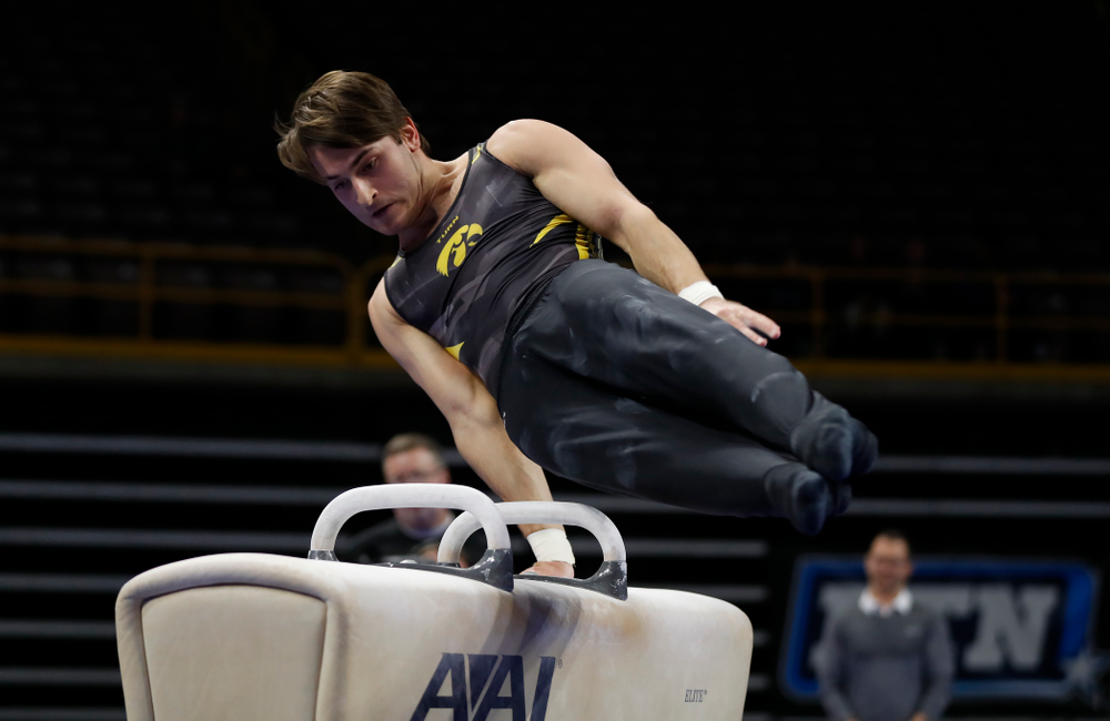 Iowa's Elijah Parsells competes on the pommel horse