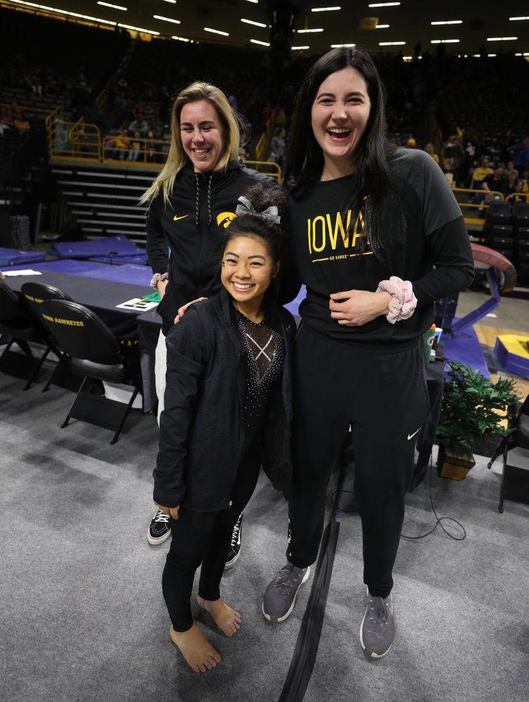 Iowa Women's Basketball seniors Megan Gustafson, Tania Davis, and forward Hannah Stewart (21) present the awards and dance the Cha Cha Slide following the Gymhawks meet against Illinois Saturday, February 16, 2019 at Carver-Hawkeye Arena. (Brian Ray/hawkeyesports.com)