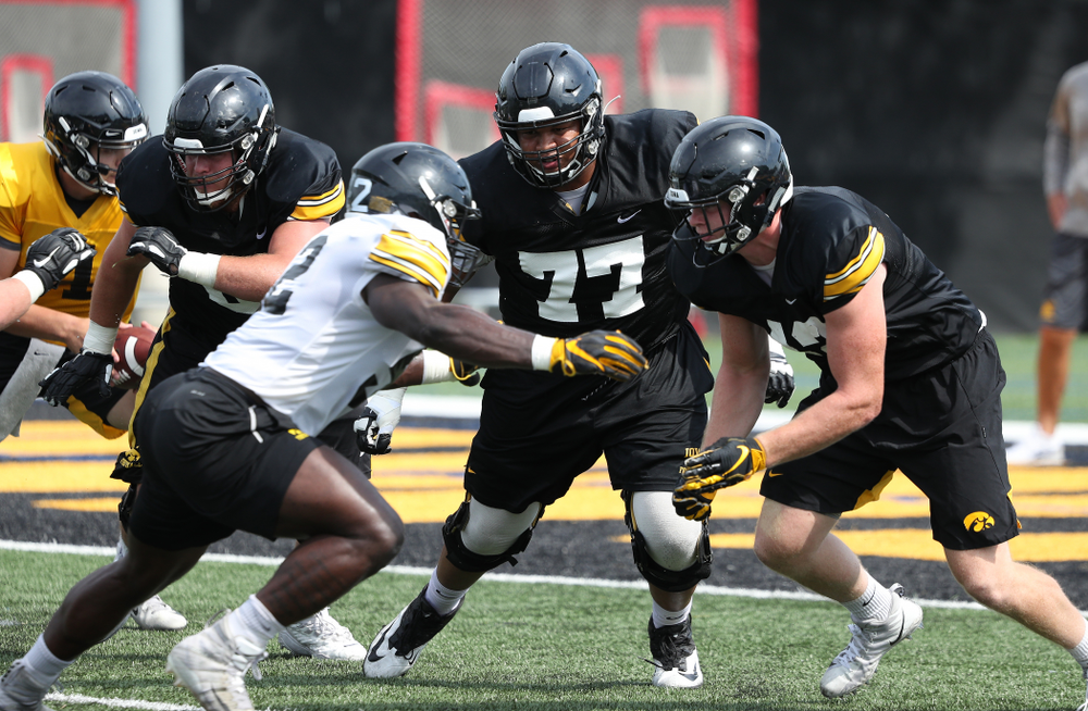Iowa Hawkeyes offensive lineman Alaric Jackson (77) during Fall Camp Practice No. 4 Monday, August 5, 2019 at the Ronald D. and Margaret L. Kenyon Football Practice Facility. (Brian Ray/hawkeyesports.com)