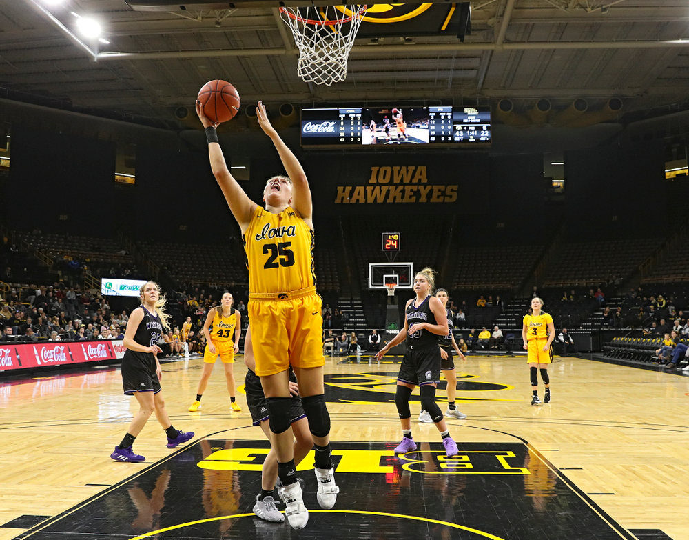 Iowa forward/center Monika Czinano (25) makes a basket during the second quarter of their game against Winona State at Carver-Hawkeye Arena in Iowa City on Sunday, Nov 3, 2019. (Stephen Mally/hawkeyesports.com)