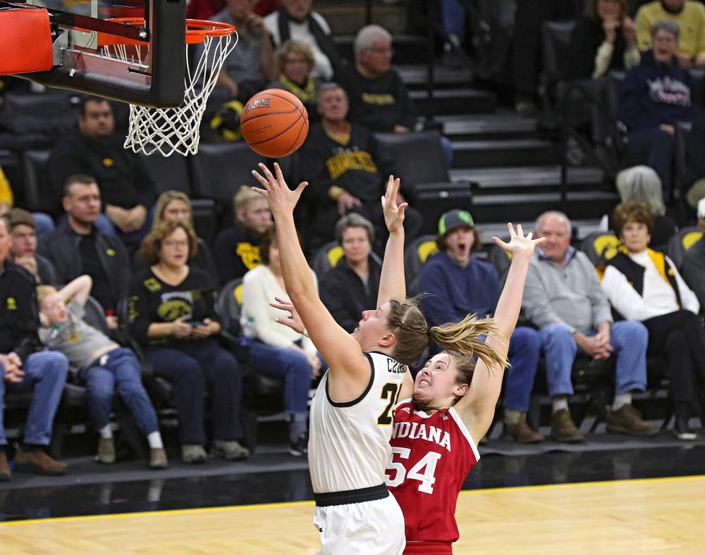 Iowa Hawkeyes forward Monika Czinano (25) scores a basket during the fourth quarter of their game at Carver-Hawkeye Arena in Iowa City on Sunday, January 12, 2020. (Stephen Mally/hawkeyesports.com)