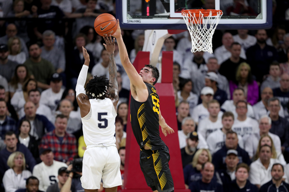 Iowa Hawkeyes forward Luka Garza (55) blocks a shot against Penn State Saturday, January 4, 2020 at the Palestra in Philadelphia. (Brian Ray/hawkeyesports.com)