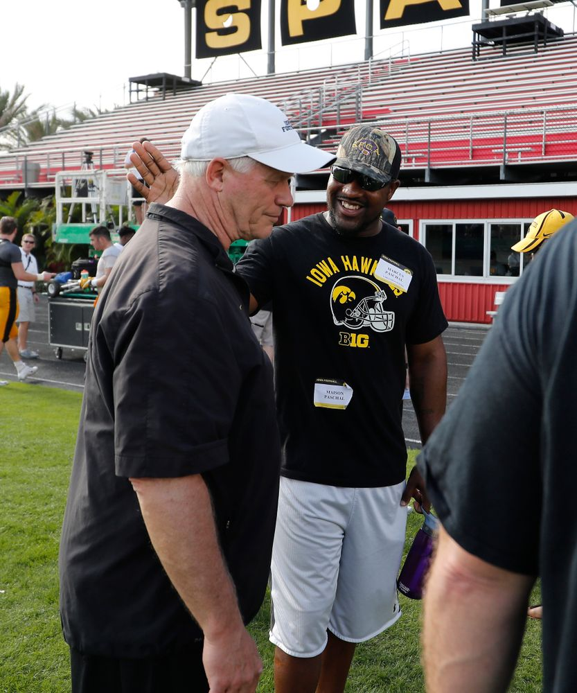 Iowa Hawkeyes defensive line coach Reese Morgan talks with former Hawkeye Marcus Paschal during Outback Bowl practice Thursday, Dec. 29, 2016 at Tampa University. (Brian Ray/hawkeyesports.com)