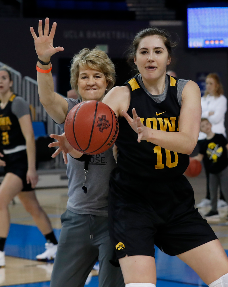 Iowa Hawkeyes forward Megan Gustafson (10) works against head coach Lisa Bluder during practice Friday, March 16, 2018 at Pauley Pavilion on the campus of UCLA. (Brian Ray/hawkeyesports.com)