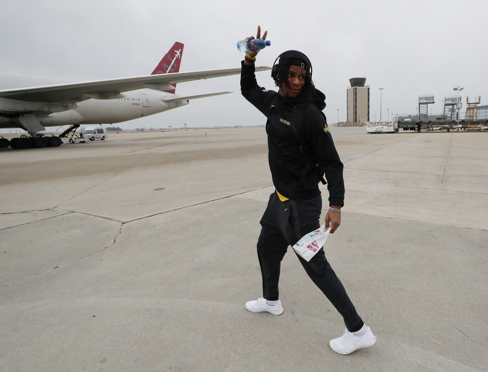 Iowa Hawkeyes wide receiver Ihmir Smith-Marsette (6) boards the team plane Wednesday, December 26, 2018 as they travel to Tampa, Florida for the Outback Bowl. (Brian Ray/hawkeyesports.com)