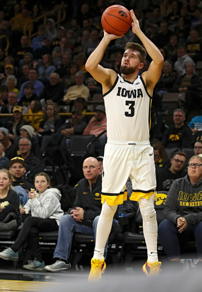 Iowa Hawkeyes guard Jordan Bohannon (3) makes a 3-pointer during the first half of their game at Carver-Hawkeye Arena in Iowa City on Friday, Nov 8, 2019. (Stephen Mally/hawkeyesports.com)