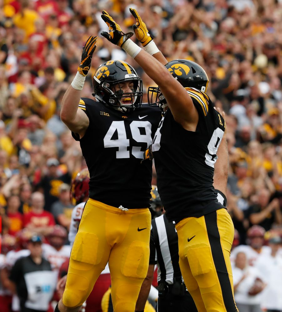Iowa Hawkeyes linebacker Nick Niemann (49) celebrates with defensive end Anthony Nelson (98) after sacking Iowa State Cyclones quarterback Kyle Kempt (17) Saturday, September 8, 2018 at Kinnick Stadium. (Brian Ray/hawkeyesports.com)