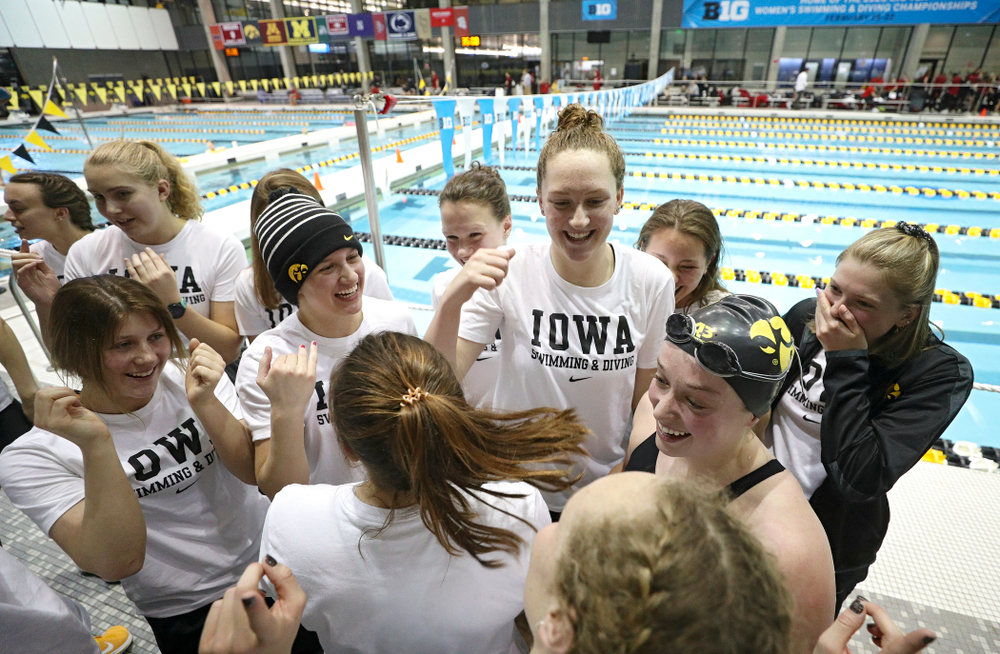 Iowa's Kelsey Drake is greeted by teammates after she broke a school record in a 200 yard butterfly time trial during the 2020 Big Ten Women's Swimming and Diving Championships at the Campus Recreation and Wellness Center in Iowa City on Wednesday, February 19, 2020. (Stephen Mally/hawkeyesports.com)