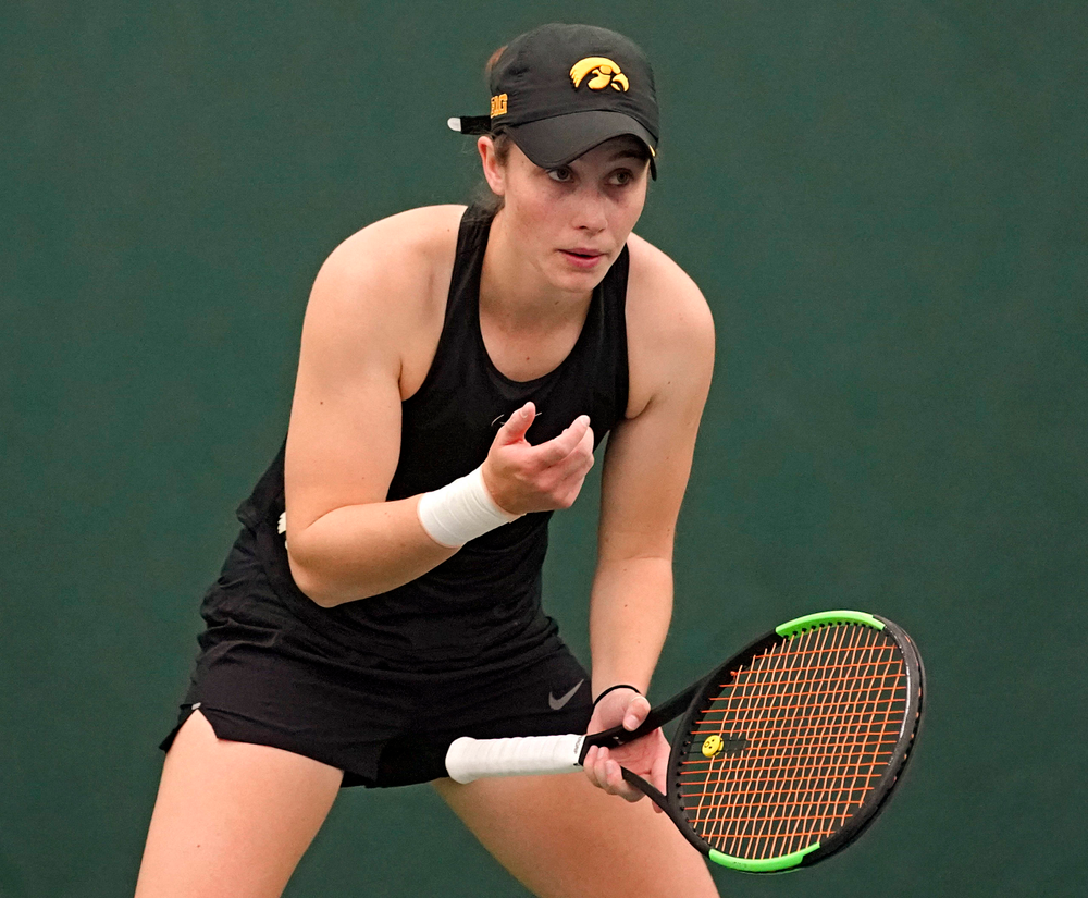Iowa's Elise van Heuvelen Treadwell blows in her hand before a serve during a match against Indiana at the Hawkeye Tennis and Recreation Complex in Iowa City on Sunday, Mar. 31, 2019. (Stephen Mally/hawkeyesports.com)