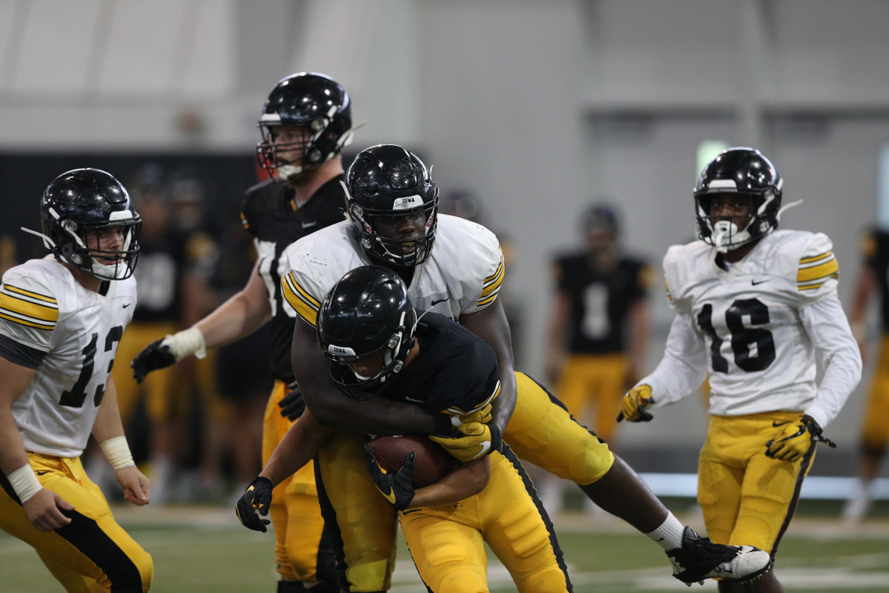 Iowa Hawkeyes defensive tackle Daviyon Nixon (54) and wide receiver Oliver Martin (5) During Fall Camp Practice No. 6 Thursday, August 8, 2019 at the Ronald D. and Margaret L. Kenyon Football Practice Facility. (Brian Ray/hawkeyesports.com)